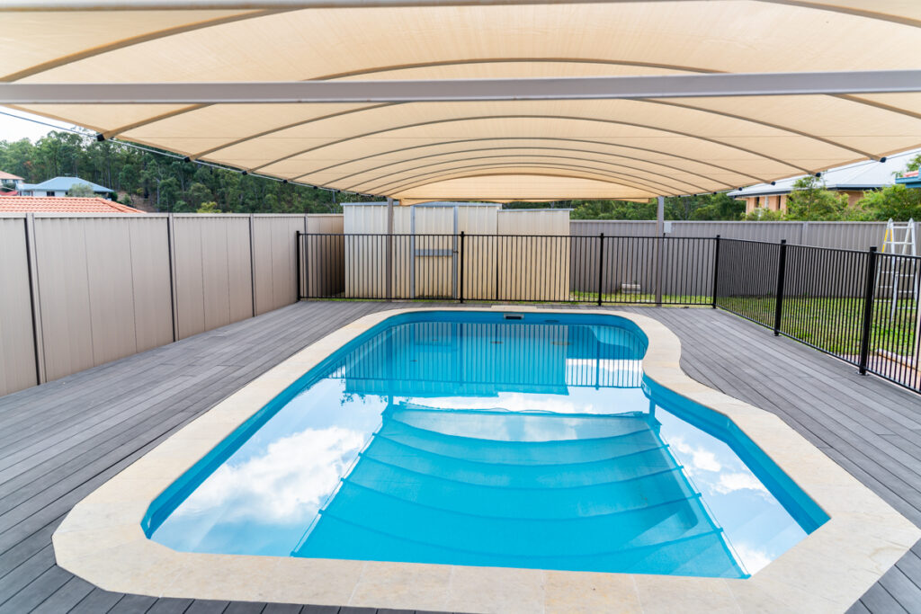 Cool Arch shade pool cover Brisbane and beyond pictured above